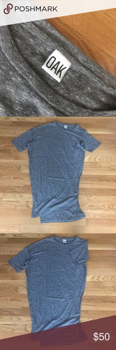 Long Drop Shoulder Tee Features: Crew neck, Drop shoulder on right, Slits up sides, Extended back hem. Composition: 100% Cotton, Made in the U.S.A. OAK Tops Tees - Short Sleeve