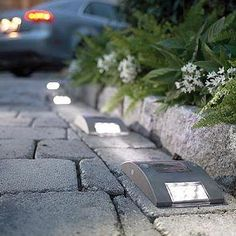 Add lights to your driveway to help light up your entrance.