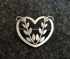Georg Jensen Sterling Silver Heart PinA stunning piece from the totally remarkable Georg Jensen! Exquisite quality in fine sterling silver and HIGHLY collectible. Who on earth doesn't love Jensen ! And Valentine's Day is coming up!  Perfect!