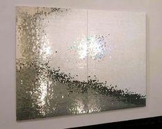 Mirrored tiles to create artwork. Lovely.