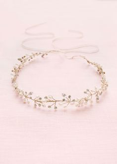 This soft golden hair vine is scattered with tiny enamel flowers and Swarovski crystals.