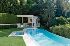 Decorator Waldo Fernandez replaced the old pool in his Los Angeles home with a limestone version of his own design and built a poolhouse.