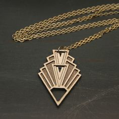 Art deco inspired, laser cut wood geometric necklace. This long necklace literally looks great with any outfit!