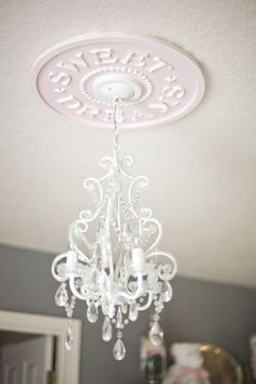 Nursery Ceiling Medallion by Marie Ricci. Shown in distressed pale pink. Photo courtesy of Jessica Wilcox, On to Baby Blog. $145