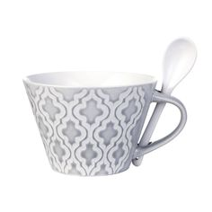 Grey and white patterned ceramic mug with spoon. Add a personal touch of individuality into your interior with the exquisite Abella Bowl Cup with spoon from Lene Bjerre. This delightful glazed ceramic mug is decorated with a shapely diamond pattern reminiscent of traditional Moorish ceramic design. It's simple shape and subtle grey and white colour palette stays true to Lene Bjerre's signature Scandinavian traditions and is the perfect addition to inject on-trend style into your home…