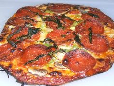Whole Wheat Flatbread Pizza with Our House Marinara, Onions, Green Pepper, Roasted Red Pepper, Crimini Mushrooms, Fresh Basil
