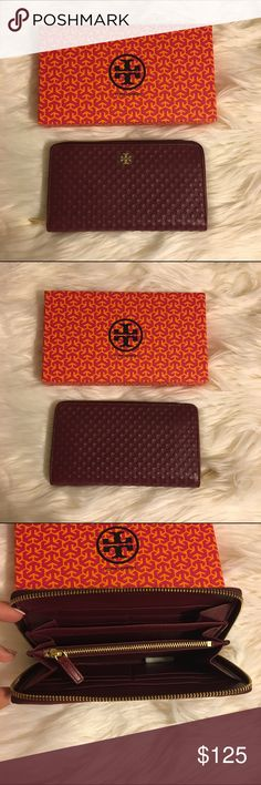 """Tory Burch Marion Embossed Continental Wallet Tory Burch Marion Embossed Wallet in burgundy  Diamond-embossed leather lends a rich quilted look to Tory Burch's ziparound continental wallet.  * Leather * Zip closure; lined * Two interior bill slots, interior zip pocket, eight card slots ❗️THERE IS ONE SMALL FLAW; ZIPPER ON INSIDE IS A LITTLE HARD TO USE WHICH IS WHY IM SELLING FOR SUCH AN AWESOME PRICE. ITS BRAND NEW JUST HAS A SMALL DEFECT. ❗️ * 7.17""""L x 2.67""""W x 4.78 """"H * 100% authentic…"""