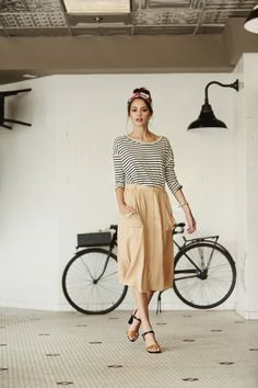 A little bit of Parisian chic. Midi skirt and stripes, with a pop of colour in a floral headband #ParisianStyle