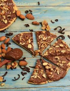This nutty and chocolaty pizza is perfect for kids, and kindles awake the childishness in adults too! Made quickly and easily with a spread of Nutella and a topping of finely chopped nuts, the Chocolate Pizza has an exotic hazelnut flavour, which intensifies upon baking, making it impossible to resist!