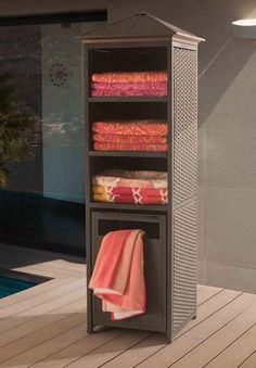 The Donnelly towel valet and storage cabinet provides ample storage space for pool accessories, towels or toys. This towel valet also features a hinged pull out storage bin with a screened bottom that can hold used towels or trash. Beach Towel Storage, Patio Storage, Outdoor Storage, Kitchen Storage, Pool Bad, My Pool, Pool Cabana, Pool Organization, Pool Toys
