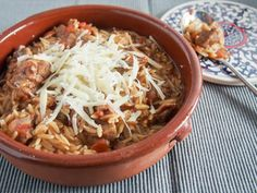 Youvetsi is a delicious Greek stew made with beef or lamb and orzo cooked in a tasty tomato-based sauce. It's flavorful, comforting and easy to make too.