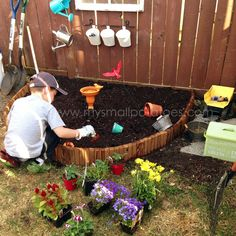 this idea but with fewer real flowers and more dump trucks and plastic flowers so kids could safely dig in the dirt and arrange flowers at will. Backyard Play, Play Yard, Backyard For Kids, Backyard Landscaping, Backyard Games, Outdoor Games, Montessori, Plastic Flowers, Real Flowers