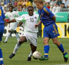 Sweden 2 Nigeria 1 in 2002 in Kobe. Jay Jay Okocha and Anders Svensson in action in Group F at the World Cup Finals.