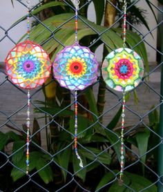 CD Mandalas - Made with crochet doilies, cds, and beads.