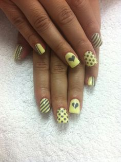 Yellow and grey nail art design..