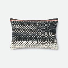 Tiny diamonds create a zig-zag motif across this minimalistic throw pillow. Incorporate solid colors and other boho-inspired pieces for a cohesively indie look.