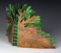 Judith Hoffman: Fern Book cover, ©2006, 4.75 x 5 x .75 inches (closed). Cover: etched and hammered copper, heat patina. Pages: watercolor paper, acrylics, Prismacolors, collage, ballpoint pen, matchbox pinhole camera photos. Bound with a coptic stitch, single page signatures.
