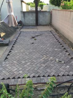 Our DIY 45 degree herringbone patio pavers are almost complete!!!