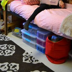 Organize and store clothes under your bed! Get Preppy College Dorm Room Ideas like this on Uscoop.com!
