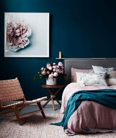 colourful bedroom with dark blue walls and pink details   how to style a bedroom