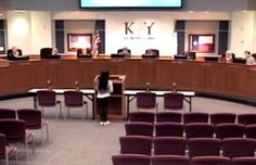 "Bearing witness. Student Jordan Wooley describes the ""God is a myth"" lesson to the Katy Independent School District's board. (Image via EAG News)"