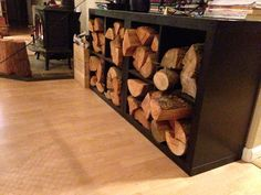 IKEA Expedit indoor firewood storage. Easy hack and looks better than a pile of wood in the living room. The depth is perfect for cord wood.