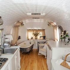 Airstream interior. All the comforts of home on the road, and with style. A cover could convert the tub into a small table as a dining area.
