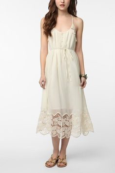 Kimchi Blue Silky Lace Hem Midi Dress, $99, available at Urban Outfitters.