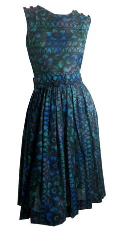 """Blue and green watercolor floral semi-sheer cotton 1960s dress with button accents on shoulders and front of wide belt. Belt snaps in back, back metal zip. No flaws. Measures 36"""" bust, 26"""" waist, 16"""""""