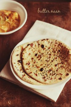 butter naan recipe - soft and healthy butter naans made with whole wheat flour/atta and on stove top. step by step recipe.