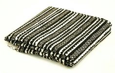 Check out this item in my Etsy shop https://www.etsy.com/listing/499949388/black-and-white-tribal-print-fabricsold