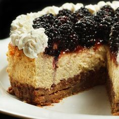 Ricotta / Mascarpone Cheesecake flavored with Lime and topped with Blackberries