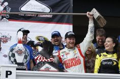 Dale Earnhardt Jr.: Dale Earnhardt Jr. poses with a broom in Victory Lane after winning at Pocono. - AP Photo