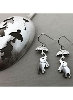 handmade and upcycled spoon flying elephant earrings