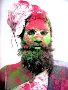 Today marks Holi Festival in India - a playful street party where carnival-goers throw brightly coloured powder and paints over one another. This photo of a man in attendance inspired Matthew and the studio for spring/summer 2013