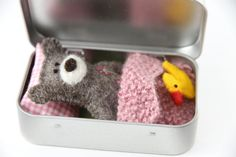 TEDDY BEAR in tin This fellow is a cute little creature born on the little island in the Atlantic Ocean. Hidden in a tin he can be carried anywhere, either in your bag or your kids pocket, ready to play whenever needed!  This set would make a perfect gift for your little ones, supporting imaginative play. It is nicely packed in a cotton bag so it is ready to be given as a present.  The set consists of teddy - natural brown, sewn from 100% wool felt, approx. 8 cm (3 inch) tall duck - rose…