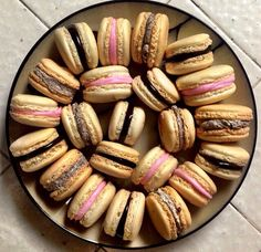 First attempt at making homemade macarons. Original almond flavor with oreo pastry pride, fudge, and pink buttercream fillings.