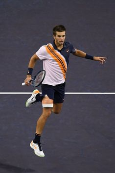 Borna Coric of Croatia hits a return against Novak Djokovic of Serbia. Shanghai, Rolex, Tennis Center, Tennis World, Ab Fab, October 14, Tennis Clothes, Rafael Nadal, Lob