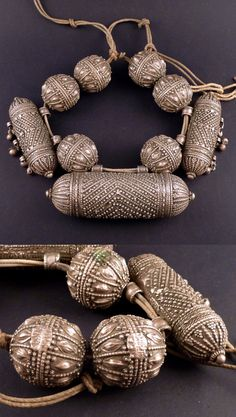 Yemen | Old necklace with one big central hirz and two smaller hirz with dances, and 6 large silver beads | Silver;