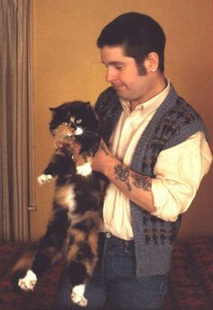 Ozzy Osbourne and his cat.