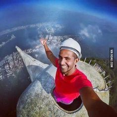 Coolest selfie I've ever seen. Guy at the very top of the Christ Redeemer statue (like in its head) in Rio de Janeiro, Brasil.