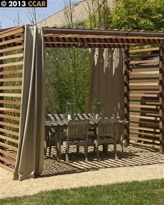 pergola with slats up the side for a wall of shade