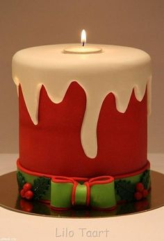 Cute Christmas Cake. Love the Candle in the center and the bow at the bottom.