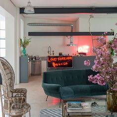Open-plan kitchen with neon signage