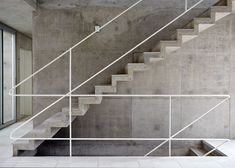 Four towers are connected by a cast-concrete staircase at the centre of this Brazilian house  :  투박한 공간을 바르게 잡아주는 선.이라는 느낌듬.