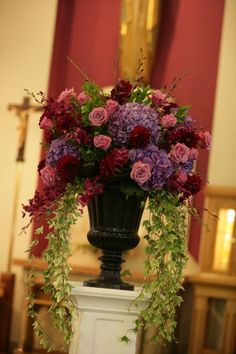 Urn Arrangement in Lavenders and Burgandy's for Church