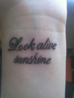 "A wonderful way to remember to stay positive. This wrist tattoo just speaks to me. ""Look alive sunshine"" of My Chemical Romance."