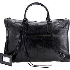 Ashley Tisdale wearing Balenciaga Arena Weekender Bag in Black.