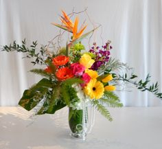 A cheerfully bright arrangement, from Dizennio Floral Boutique-Vaughan showing that several colours can be used together, by careful grouping of each tone.