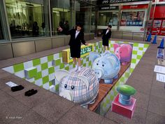 https://flic.kr/p/ea64Gd | 3d-street-art-fukuoka | 3d street art Piggy Bank in Fukuoka Japan. This 3d street painting measures 45 m2 created on vinyl in front of Iwataya department store at Tenjin district. Supported by Nishitetsu. Coördination by ONPA))))